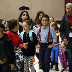 Students line up for the Breakfast in the Classroom program at Backman Elementary School in Salt Lake City on Friday, Oct. 28, 2016.