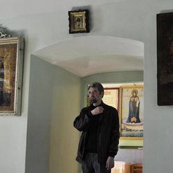 Deacon Sergei Baranov prays in a church in Tambov, Russia, on Tuesday, Sept. 18, 2012. Deacon Sergei Baranov from Tambov became the first Russian Orthodox cleric to have walked out in protest over the church's treatment of the Pussy Riot case. Baranov, defrocked at his request, told the Associated Press in an interview, that he supports the band's stunt and does not regret his resignation.