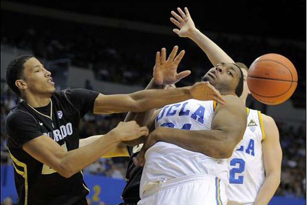 Colorado's Andre Roberson, left, is not bashful about battling with bigger boys, like UCLA's Josh Smith, for loose balls. <em>(AP photo by Mark Terrill)</em>