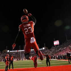 Utah Utes defensive back Julian Blackmon (23) leaps for a catch while warming up before the game against the Colorado Buffaloes at Rice-Eccles Stadium in Salt Lake City on Saturday, Nov. 25, 2017.