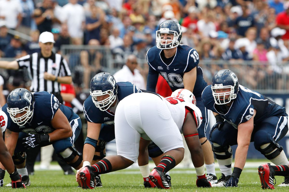 Sep 8, 2012; East Hartford, CT, USA; Connecticut Huskies quarterback Chandler Whitmer (10) at the line of scrimmage against the North Carolina State Wolfpack during the first half at Rentschler Field. Mandatory Credit: David Butler II-US PRESSWIRE