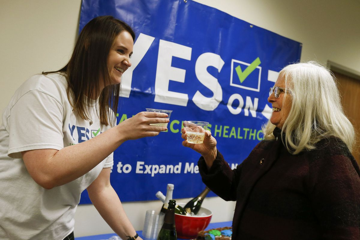Courtney Bullard, education and collaborations director for the Utah Health Policy Project, and Nancy Mitchell, toast during a Medicaid expansion celebration and enrollment event at thenonprofit organization officesin West Valley City on Wednesday, Jan. 15, 2020.