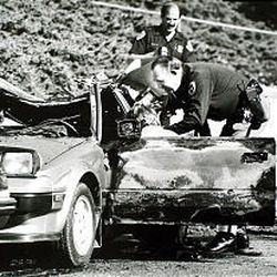 Police investigate Mark Hofmann's car at 200 North and Main on Oct. 16, 1985, after a bomb he created exploded, injuring the forger.