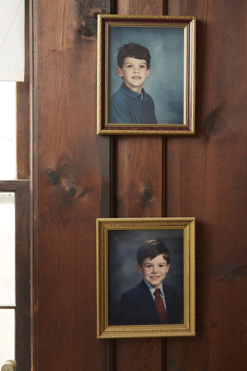 Photographs on a wall of Ed Fahy as a child (top) and one of his brothers (bottom).