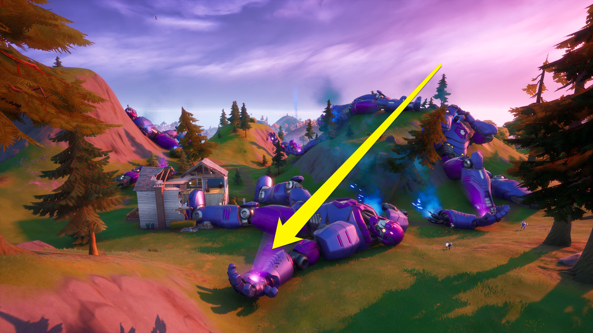 A dead Sentinel in Fortnite with an arrow pointing to its hand