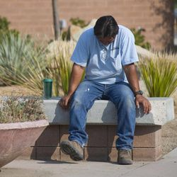 Thomas Herrera waits for news about whether or not his home survived the Yarnell Hill Fire on Monday, July 1, 2013, at the Red Cross shelter at Yavapai College in Prescott, Ariz. The wildfire destroyed 200 houses in the town of Yarnell and the nearby community of Glen Isla. Nineteen firefighters from an elite crew from Prescott were killed in the blaze.
