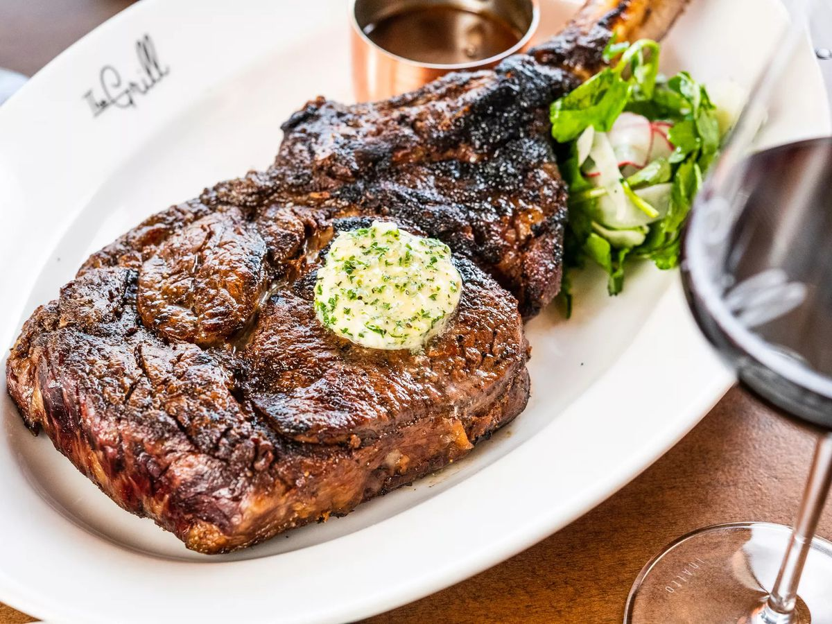 Bone-in tomahawk for two from Creekstone Farms ($119) at the Grill.