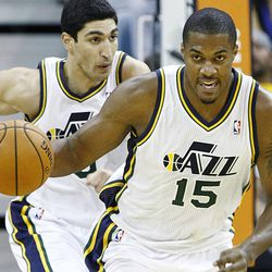 Utah Jazz's power forward Derrick Favors (15) leads the fast break with teammate Utah Jazz's center Enes Kanter (0) following as the Jazz and the Rockets play Saturday, Nov. 2, 2013 in Energy Solutions arena.
