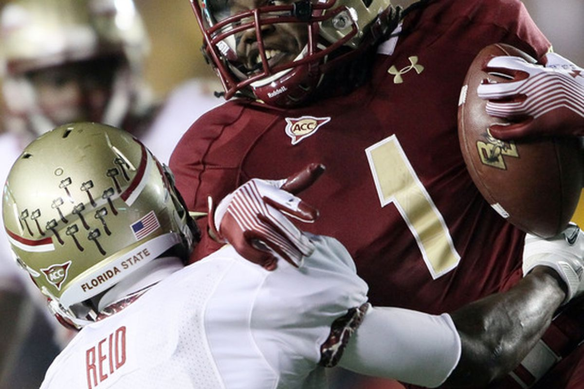 CHESTNUT HILL, MA - NOVEMBER 03:  Colin Larmond Jr. #1 of the Boston College Eagles is tackled by Greg Reid #5 of the Florida State Seminoles on November 3, 2011 at Alumni Stadium in Chestnut Hill, Massachusetts.  (Photo by Elsa/Getty Images)