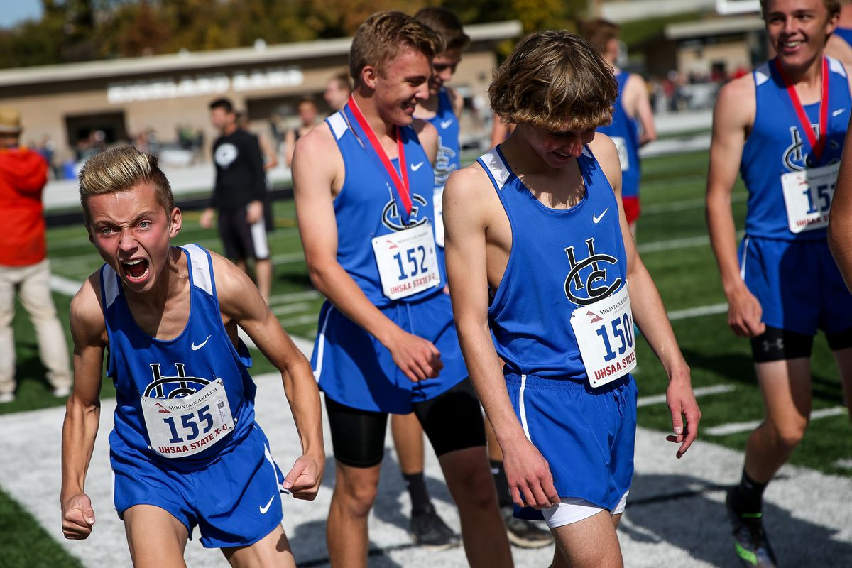 Carbon's Braxton Ware screams as he and teammates accept their first-place team trophy in the 3A boys cross country championship at Highland High School in Salt Lake City on Wednesday, Oct. 23, 2019.