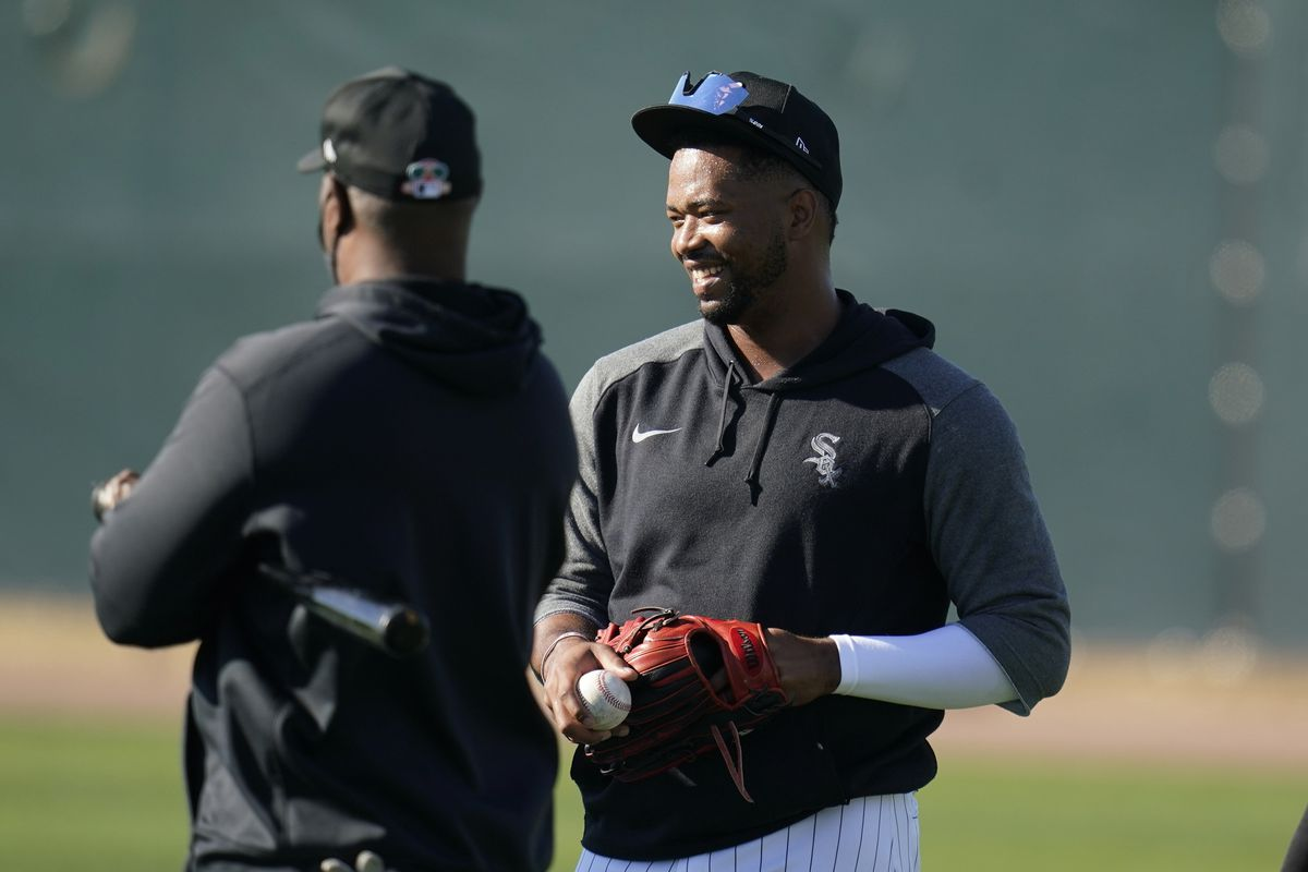 White Sox outfielder Eloy Jimenez, right, talking with outfielders coach Daryl Boston last month, will be out five to six months with a left pectoral tendon rupture.