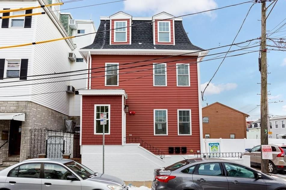 A square-ish three-story house.