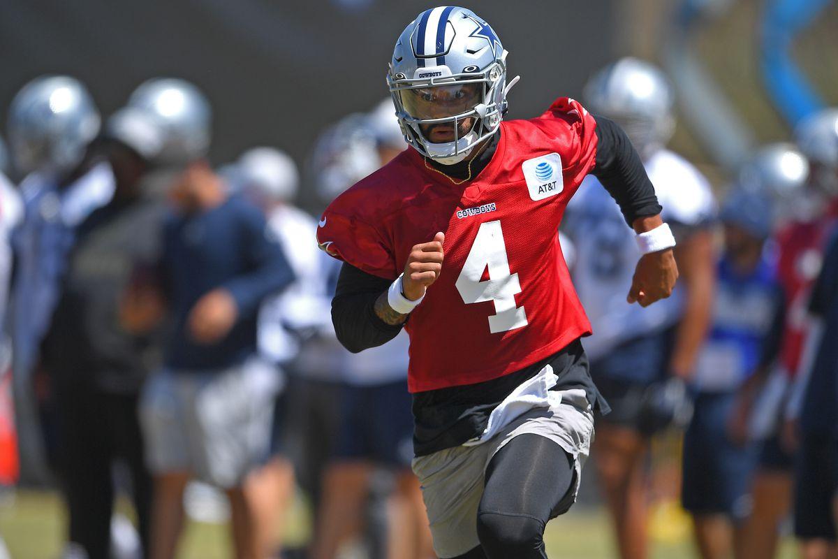 Quarterback Dak Prescott #4 of the Dallas Cowboys participates in drills during practice at River Ridge Complex on August 3, 2021 in Oxnard, California.