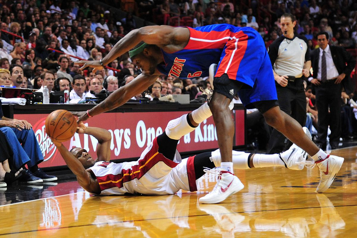 April 8, 2012; Miami, FL, USA; Miami Heat small forward James Jones (22) chases a loose ball Detroit Pistons center Ben Wallace (6) during the first half at American Airlines Arena. Mandatory Credit: Steve Mitchell-US PRESSWIRE