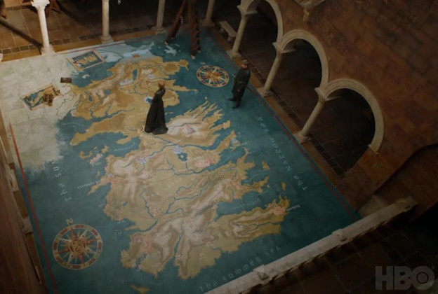 Cersei Lannister stands on a map of Westeros