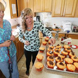 Benda Saenz and Intensive Supervision client Amanda Newsome, right, make cupcakes at Valleycore for Women in Salt Lake City on Thursday, Oct. 6, 2016.