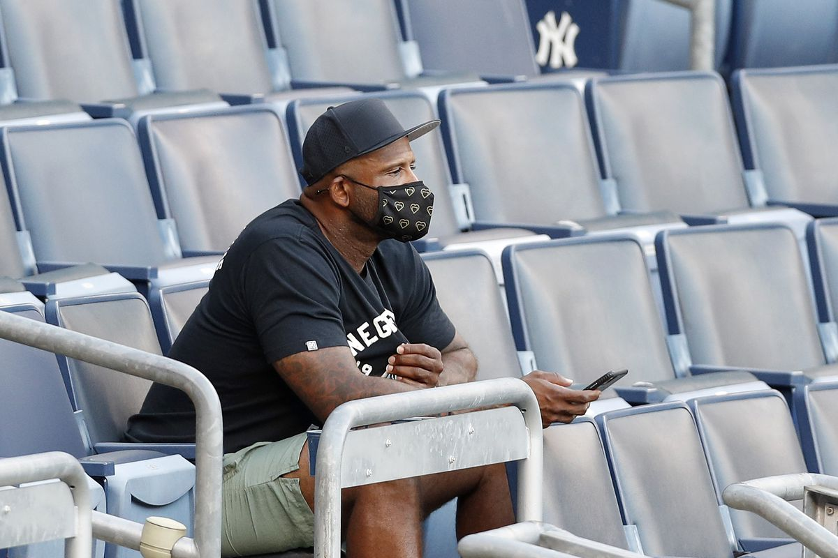 Former New York Yankee CC Sabathia watches the Yankees play against the Boston Red Sox at Yankee Stadium on July 31, 2020 in New York City.