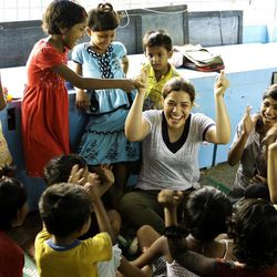 """This undated image provided by PBS shows actress America Ferrara interacting with kids in Kolkata, India. Ferrara, Meg Ryan and Olivia Wilde are among the actresses who brought their star power to the PBS documentary """"Half the Sky,"""" which details efforts to help exploited women worldwide. It airs Monday and Tuesday, Oct. 1-2."""