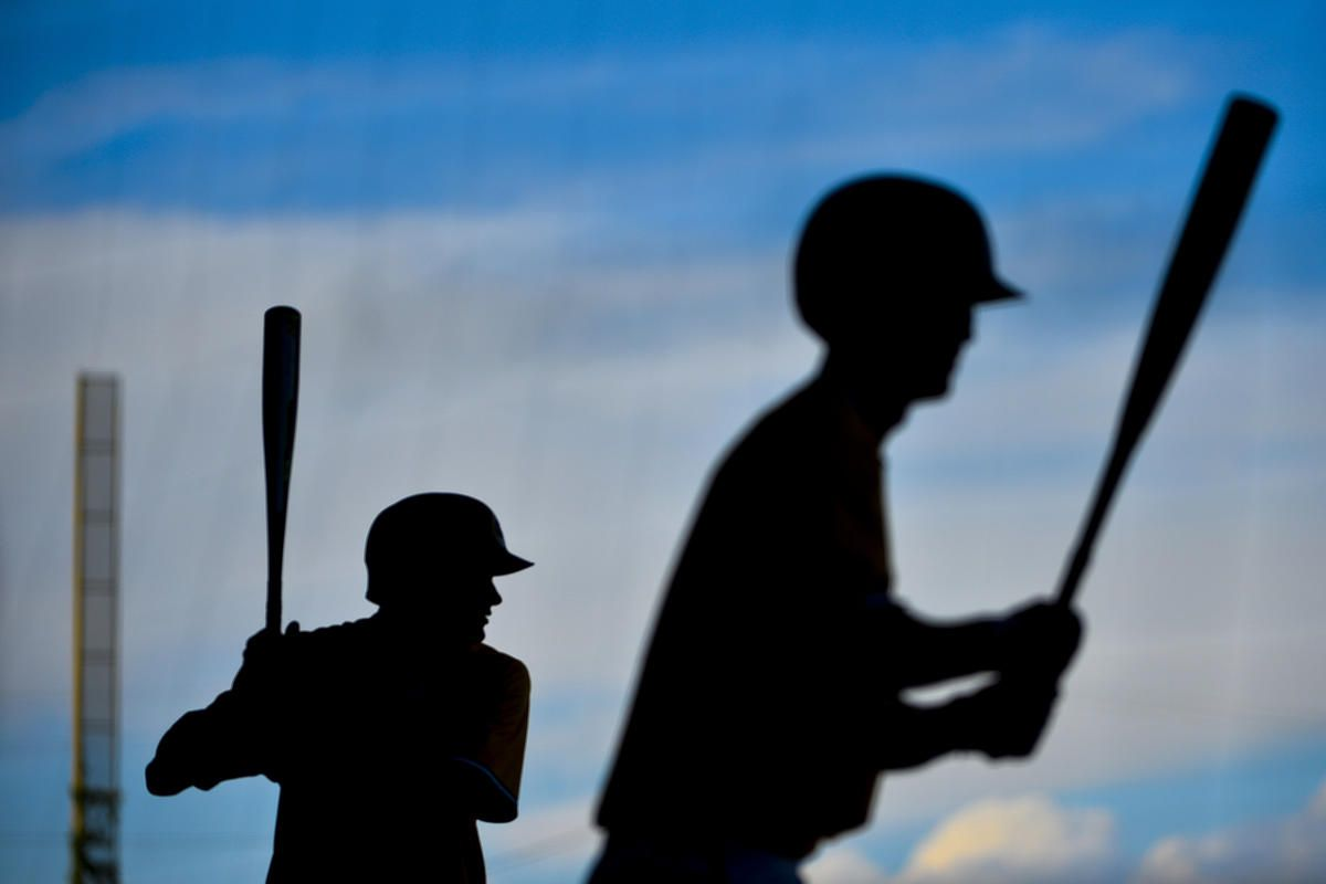 Cottonwood's Hunter Blunt and Hayden Rosenkrantz, who both earned 5A All-State honors, warm up on deck during a 5A playoff game against American Fork at Kearns High School in Kearns on Monday, May 22, 2017.