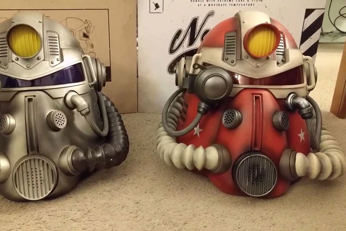 A side-by-side comparison of the Fallout 76 wearable T-51b helmet and the GameStop exclusive Nuka Cola-themed helmet sold separately online.