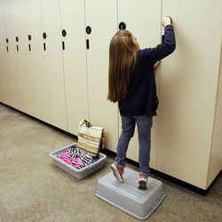 BYU student Kelsey Morasco puts away her sewing supplies after class in Provo Feb. 23, 2012.