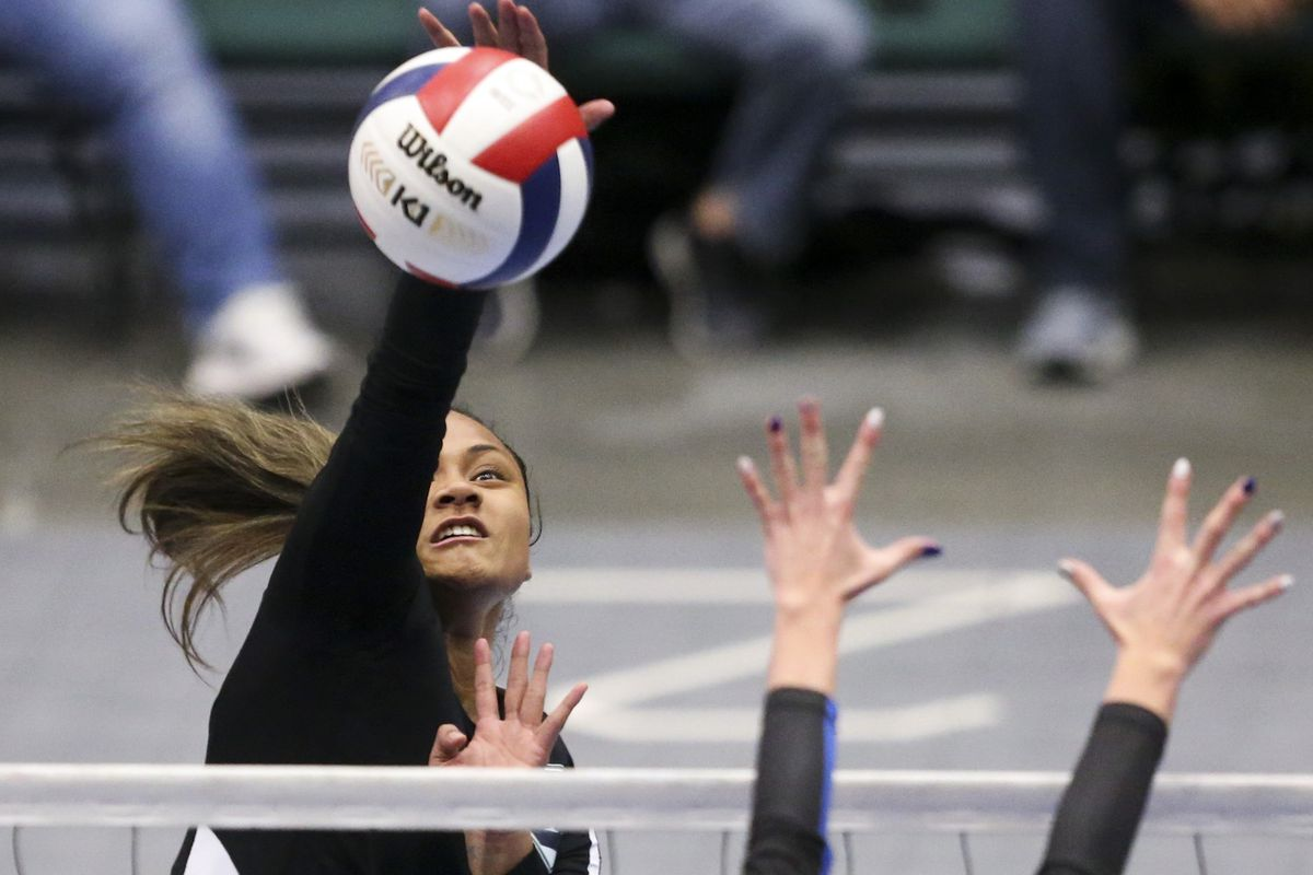 Copper Hills outside hitter Asiah Sopoaga (1) spikes the ball during the 6A high school state finals match at the UCCU Center on the Utah Valley University campus in Orem on Saturday, Nov. 9, 2019.
