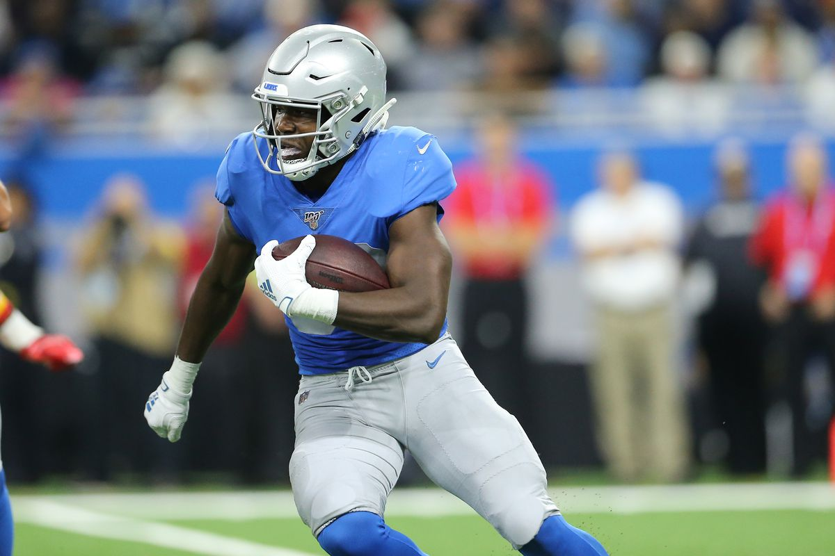 Kerryon Johnson of the Detroit Lions battles for yards aganist the Kansas City Chiefs in the second quarter of the game at Ford Field on September 29, 2019 in Detroit, Michigan.