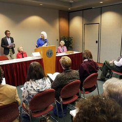 Dee Rowland, former government liaison, Catholic Diocese of Salt Lake City, introduces University of Utah biology Professor David Carrier as the Utah Citizens' Counsel announces its 2014 Assessment of Utah's Policy Progress in Salt Lake City, Wednesday, Dec. 10, 2014.