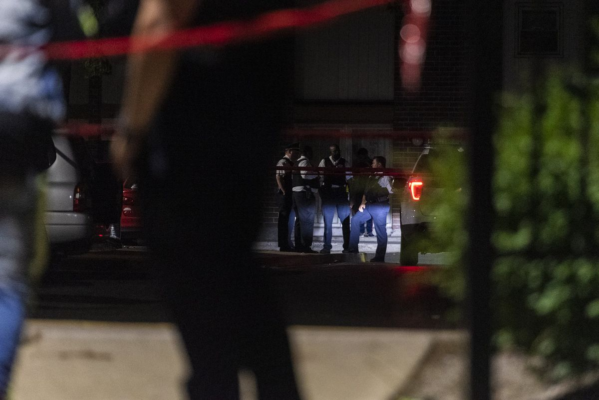 Chicago police investigate the scene where multiple people were shot, including a 9-year-old girl, June 17, 2020, in Gresham.