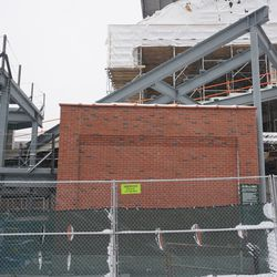 The additional seats being added above the previously constructed utility building, in the left field corner
