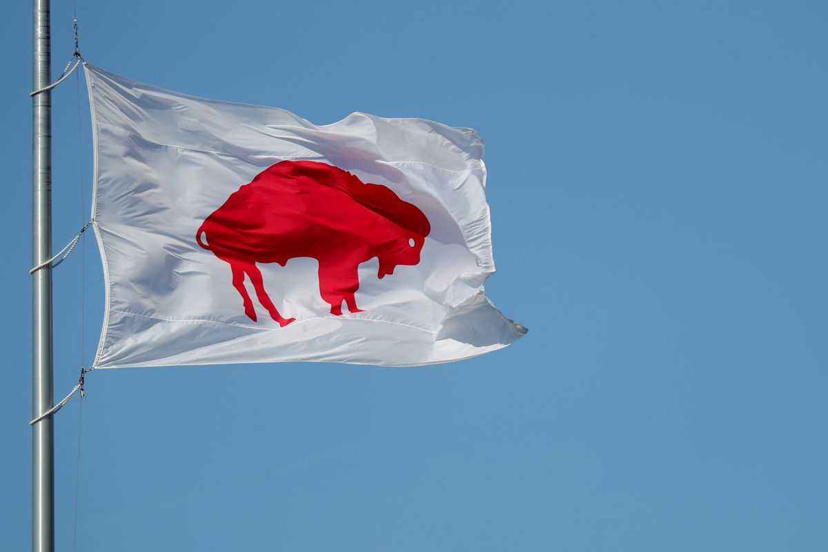 A Buffalo Bills flag flies above Bills Stadium before a game between the Buffalo Bills and the Los Angeles Rams on September 27, 2020 in Orchard Park, New York.