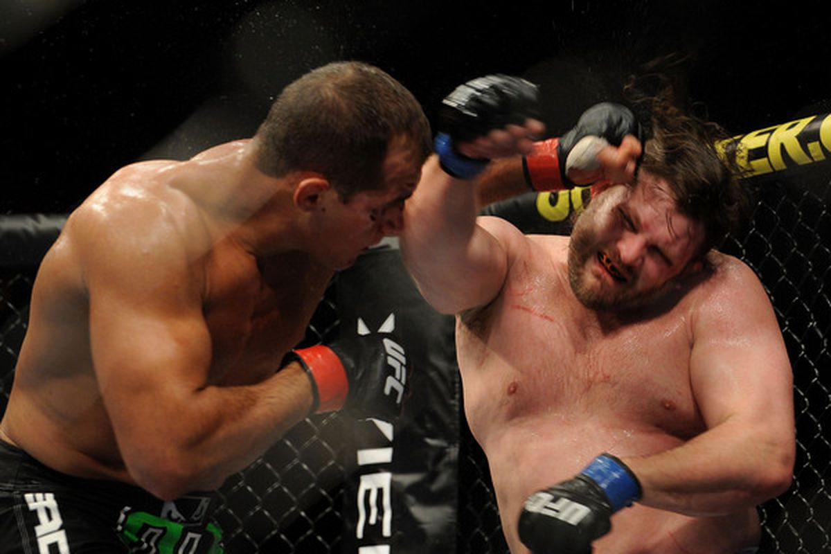 OAKLAND CA - AUGUST 07:  Junior dos Santos punches Roy Nelson (right) during the UFC Heavyweight bout at Oracle Arena on August 7 2010 in Oakland California.  (Photo by Jon Kopaloff/Zuffa LLC/Zuffa LLC via Getty Images)