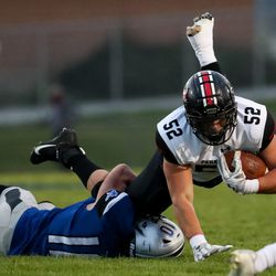 Stansbury's Bridger Thomas stops a run by Park City's Zachary Lukrich in a high school football game in Stansbury Park on Friday, Sept. 18, 2020.