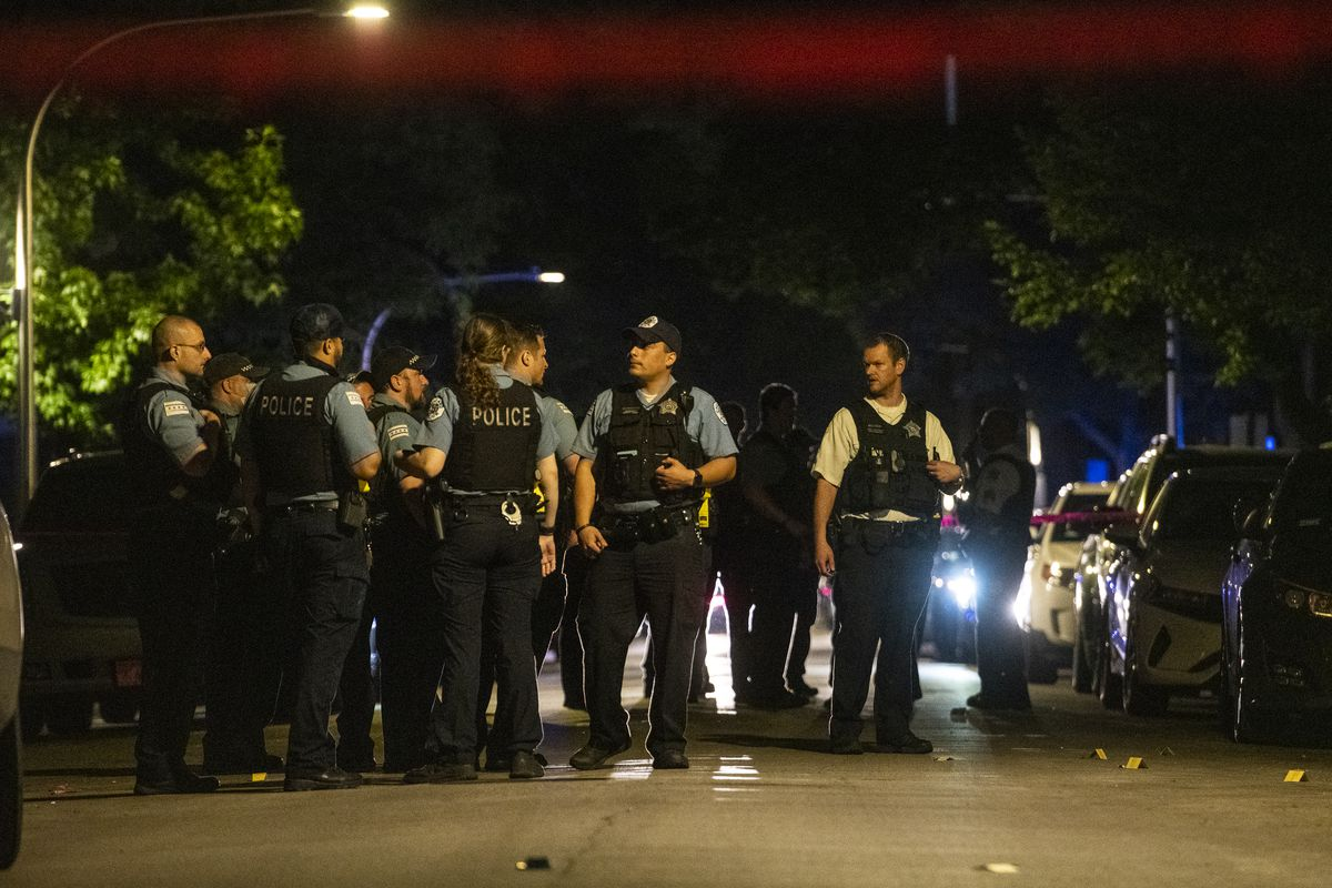 Chicago police work the scene where two people were shot in the 7600 block of South Saint Lawrence Avenue, in the Chatham neighborhood, Saturday, July 17, 2021.