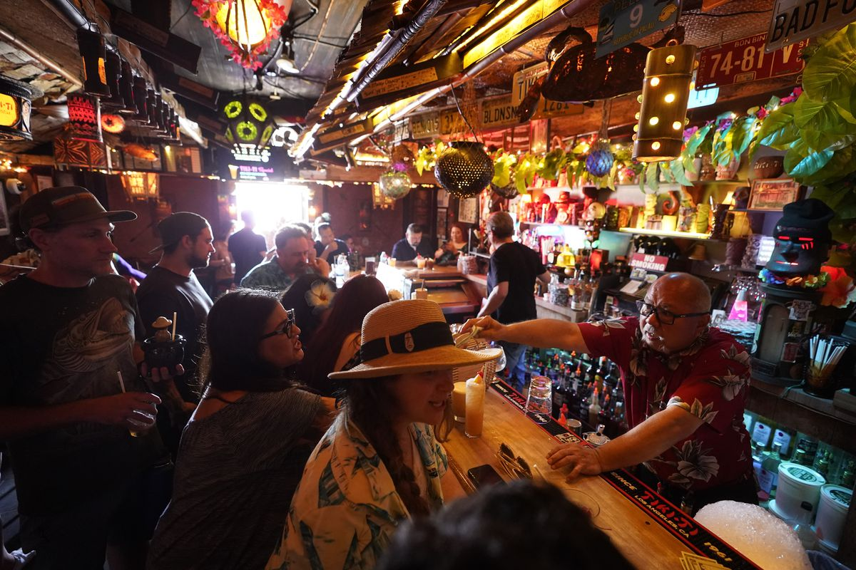 In this Wednesday, July 7, 2021, file photo, patrons enjoy cold tropical cocktails in the tiny interior of the Tiki-Ti bar as it reopens on Sunset Boulevard in Los Angeles.