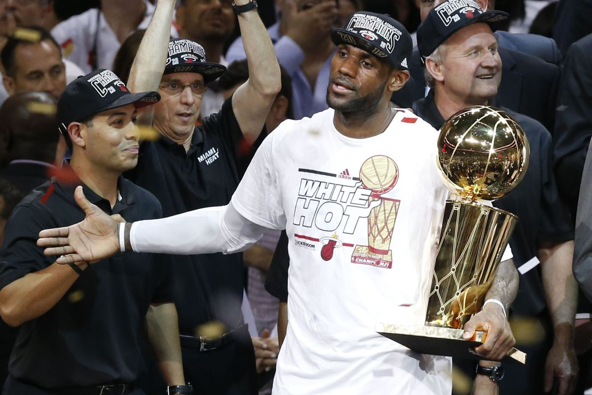 LeBron James with the Larry O'Brien.