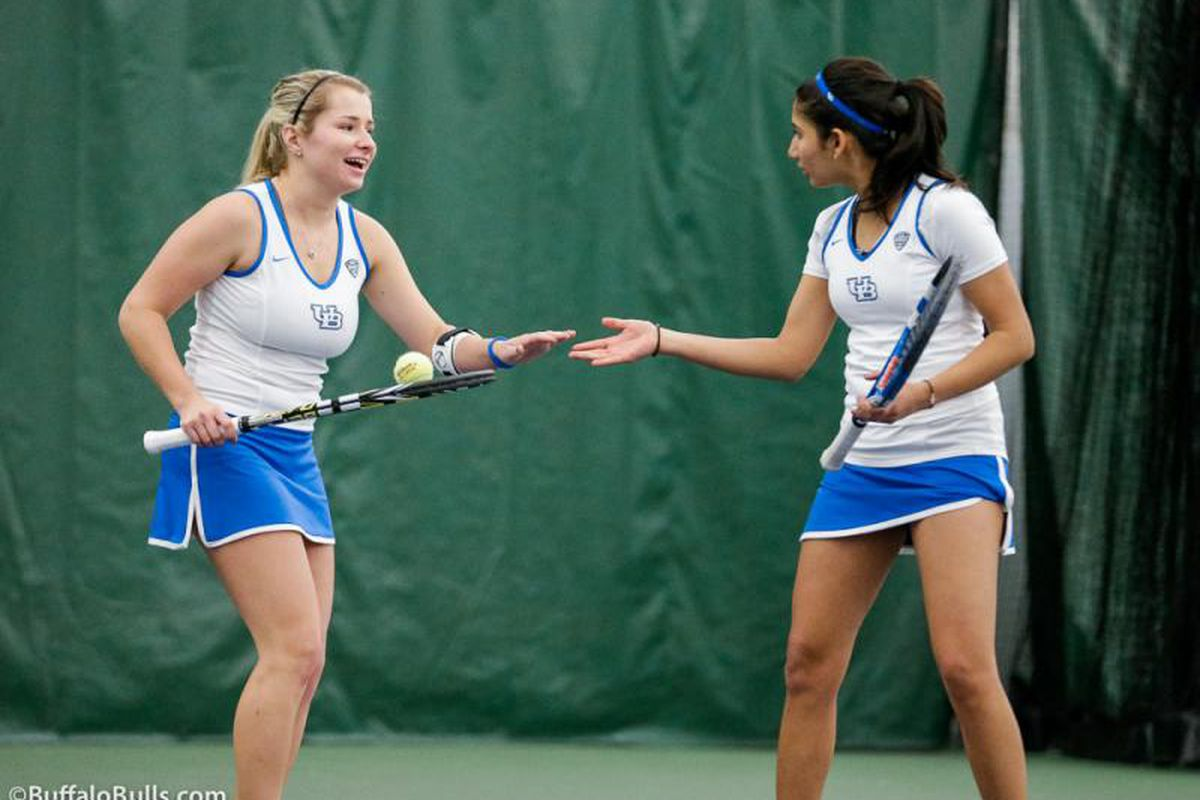 Juniors Miranda Podlas and UB Female Athlete of the Week Tanvi Shah Celebrate during their doubles match.