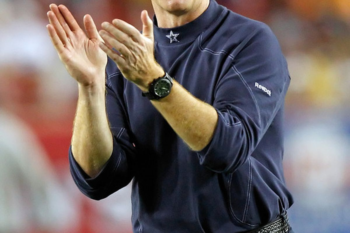 TAMPA, FL - DECEMBER 17:  Head coach Jason Garrett of the Dallas Cowboys cheers on his team during warmups against the Tampa Bay Buccaneers at Raymond James Stadium on December 17, 2011 in Tampa, Florida.  (Photo by J. Meric/Getty Images)