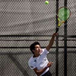 Rowland Hall's Jaiden Handlon serves against Waterford's Lalith Suresh in the 3A boys tennis No. 1 singles championship match at Liberty Park in Salt Lake City on Saturday, May 22, 2021.