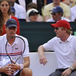 John Isner of US, left, listens to his Davis Cup manager Jim Courier during the Davis Cup World Group semifinal tennis match against Spain's David Ferrer, in Gijon, northern Spain, Sunday, Sept. 16, 2012. Ferrer won 6-7,  6-3,  6-4, 6-2.