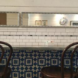 With blue and white tile and charming bistro seating, Eva's Bakery has all the trappings of a Parisian cafe.