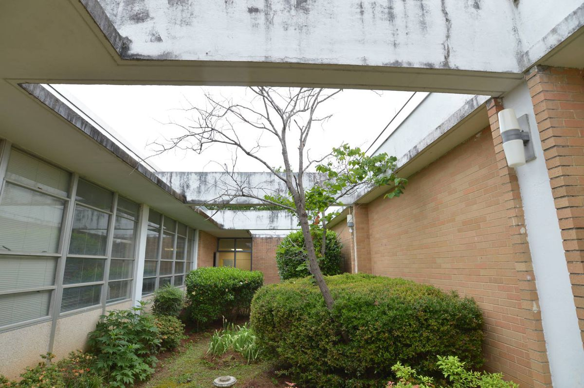 A courtyard at a 1960s school that's unused.