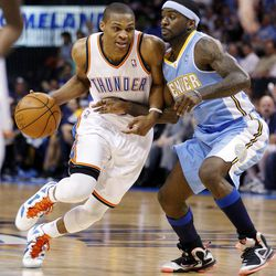 Oklahoma City Thunder guard Russell Westbrook, left, drives around Denver Nuggets guard Ty Lawson during the first quarter of an NBA basketball game in Oklahoma City, Wednesday, April 25, 2012. Denver won 106-101.