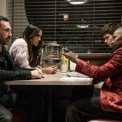 "Buddy (Jon Hamm), Darling (Eiza Gonzalez), Baby (Ansel Elgort) and Bats (Jamie Foxx) discuss the next heist in ""Baby Driver."""