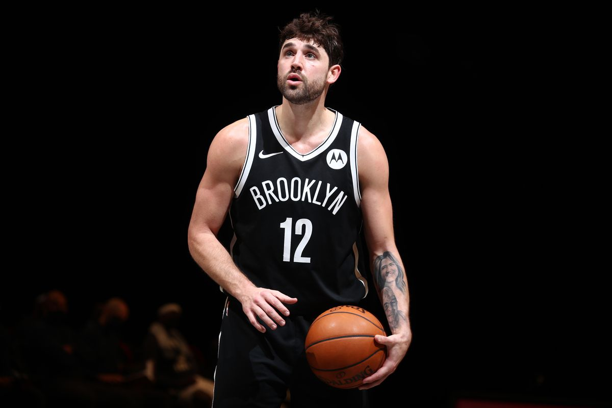 Joe Harris of the Brooklyn Nets shoots a foul shot during the game against the Milwaukee Bucks on January 18, 2021 at Barclays Center in Brooklyn, New York.