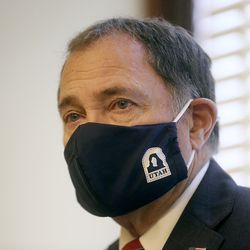 Gov. Gary Herbert wears a mask while listening to other speakers during a COVID-19 briefing at the Capitol in Salt Lake City on Thursday, July 16, 2020.