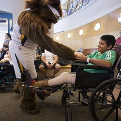 Jazz Bear gives a teddy bear to Angel Gabriel Olivas Vargas that was donated by Canopies for Kids at Shriners Hospitals for Children in Salt Lake City on Thursday, Sept. 14, 2017.
