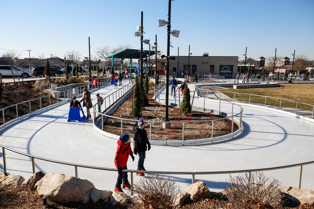 People skate at the new Bountiful Ice Ribbon during its grand opening at Bountiful Town Square in Bountiful on Saturday, Dec. 5, 2020.
