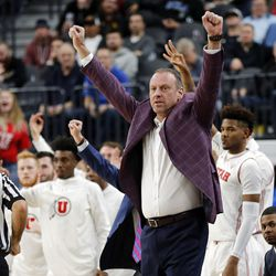The Utah Utes and Utah Utes head coach Larry Krystkowiak celebrate a play against the Oregon Ducks during the Pac-12 basketball tournament in Las Vegas on Thursday, March 8, 2018.