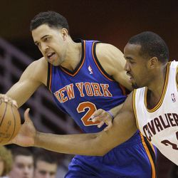 New York Knicks' Landry Fields (2) and Cleveland Cavaliers' Samardo Samuels (24) battle for a loose ball in the first quarter in an NBA basketball game on Friday, April 20, 2012, in Cleveland.